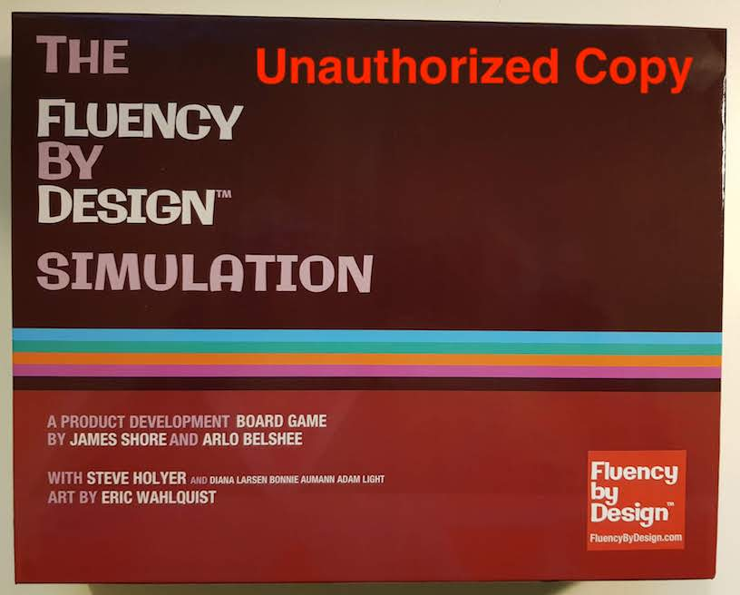 Picture of The FluencyByDesign Simulation box set. The credits say, 'A game by James Shore and Arlo Belshee with Steve Holyer and Diana Larsen Bonnie Aumann Adam Light. Art by Eric Wahlquist.'